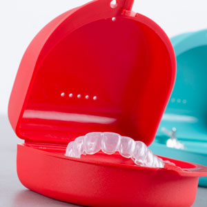 custom whitening tray in red case